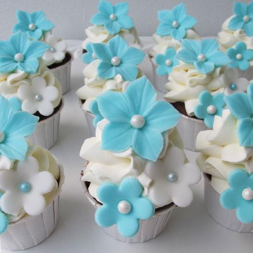 Mini cupcakes blå till dop eller födelsedag